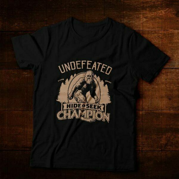 a4d6df6ab Details about Undefeated Hide and Seek Champion Funny Bigfoot Mystery Ultra  Cotton Men T-Shirt