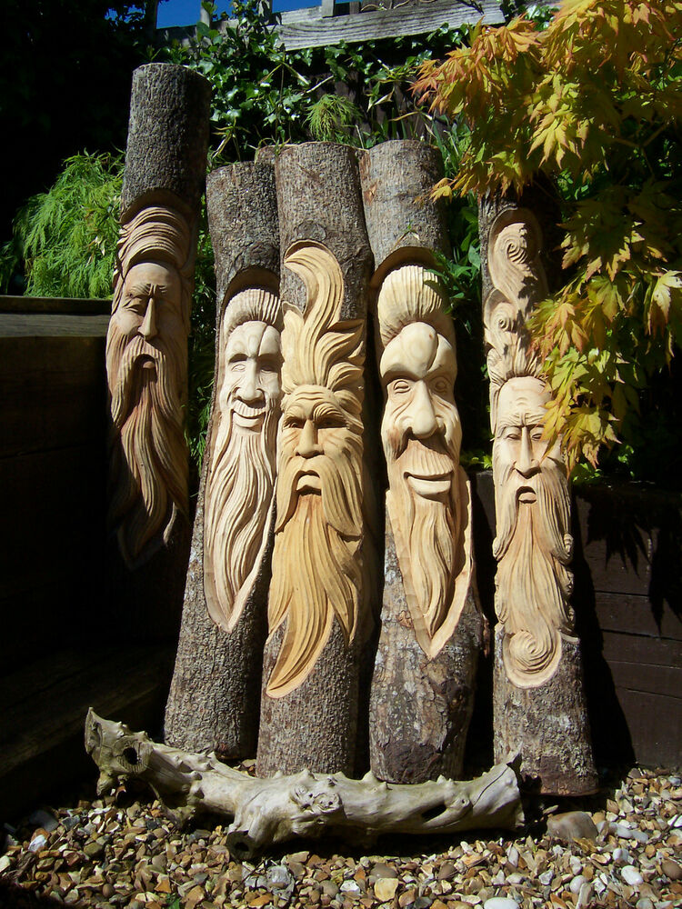 Fair trade hand carved wooden green man half tree trunk