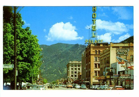 missoula mt street view store fronts palace hotel old cars postcard