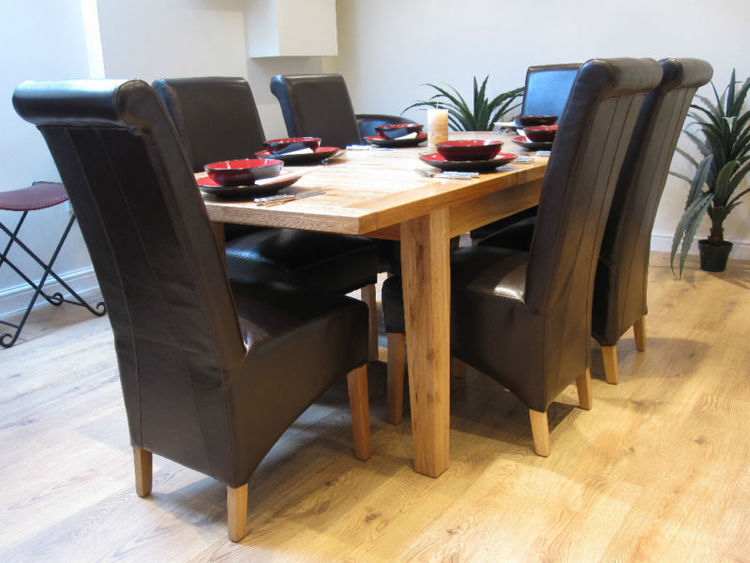 Extending solid oak dining table and six black bonded for 120 dining table sets