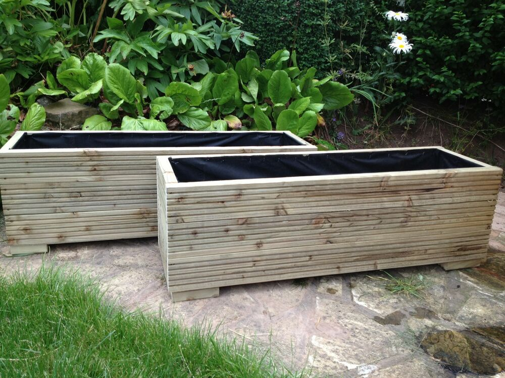 large wooden garden trough planters made in decking boards plant pots