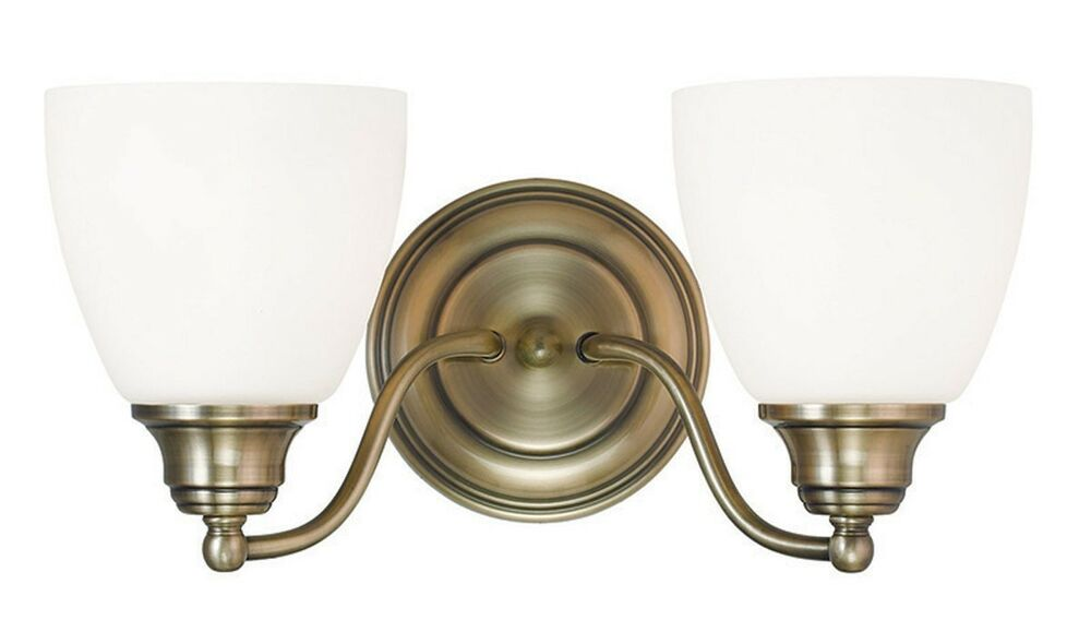 Antique brass somerville livex 2 light bathroom vanity for Vintage bathroom lighting fixtures
