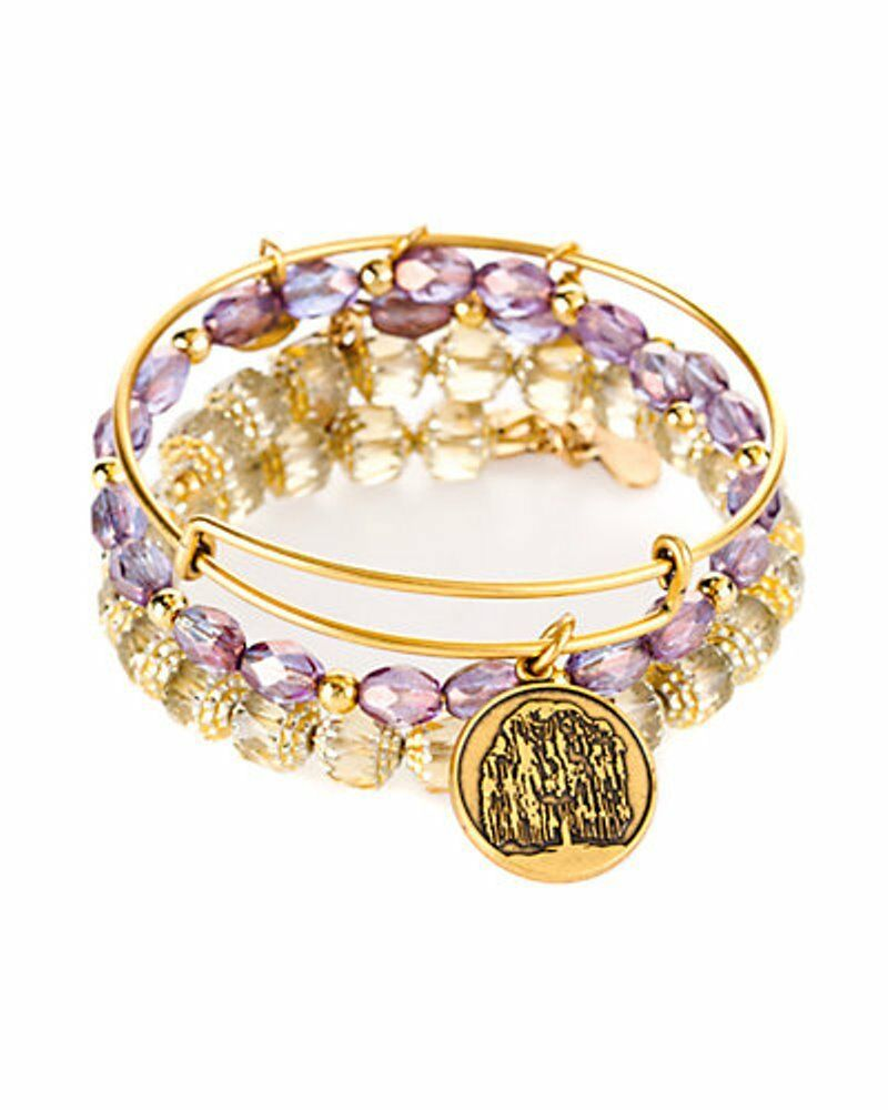 Wear this Alex and Ani Crystal Patina Heart Set of 3 bangle bracelets to celebrate your emotional center and the strength it gives you to face each day. One bangle showcases a heart charm with a marbled backdrop. Accenting this charm are two matching bangles with orange and gold-tone beads.