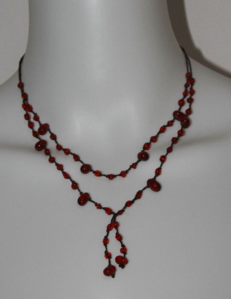 strand garnet bead necklace on brown cord