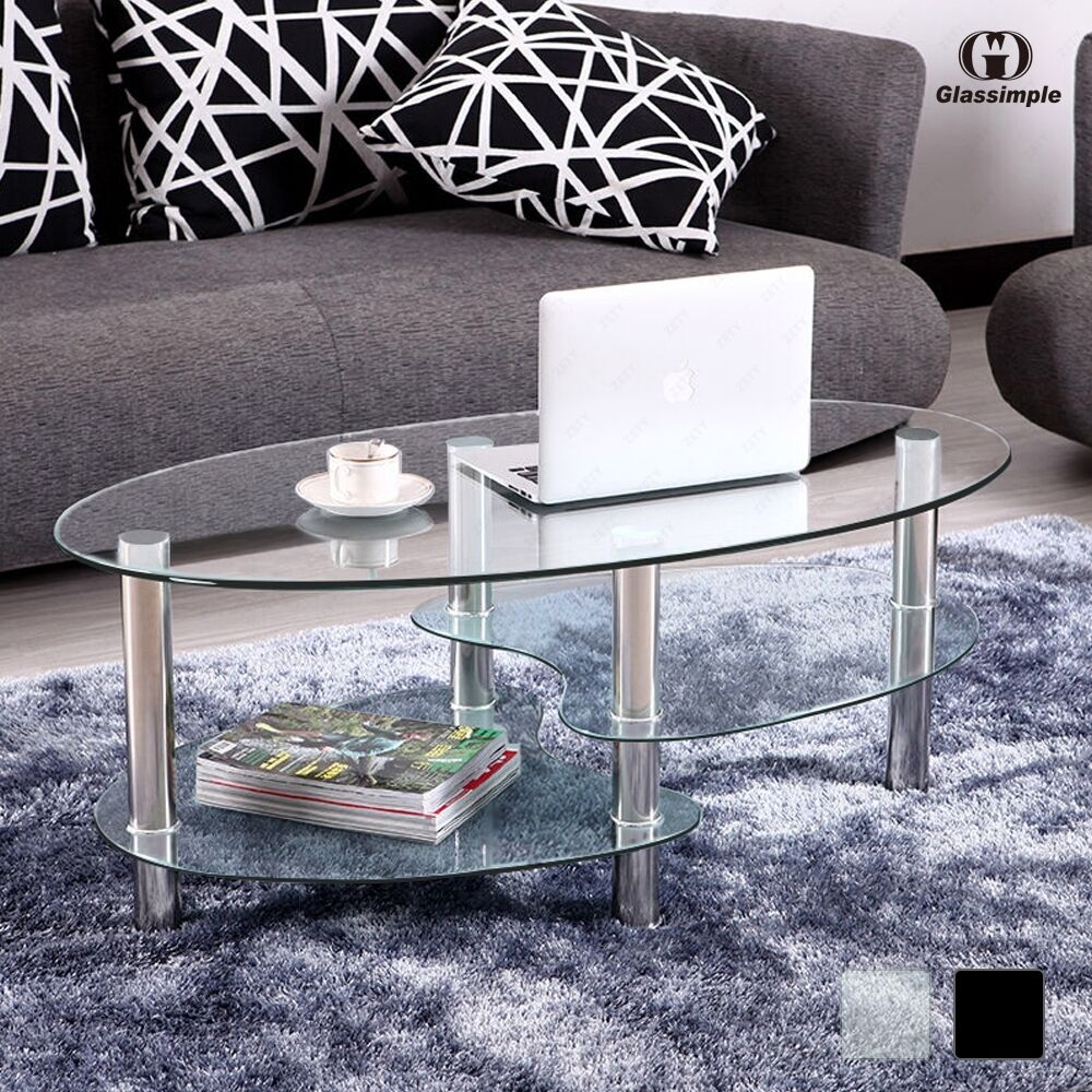 Clear black glass oval coffee table with shelves and - Glass tables for living room ...