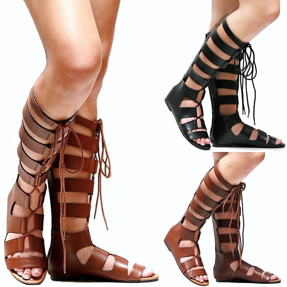 Joanie Black Jelly Knee High Gladiator Multi Buckle Thong Flat Sandals Be a trend setter with these knee high gladiator inspired flat sandals, featuring an open toe with a tong strap, contrast stit.
