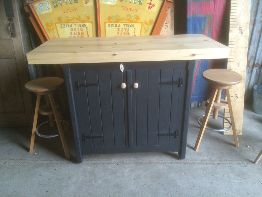 A rustic wooden freestanding kitchen island handmade for Wooden bar unit