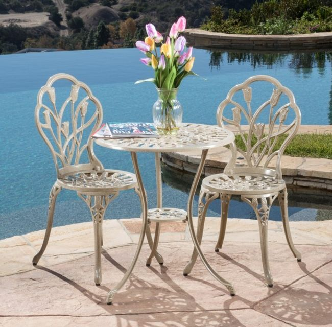 small white bistro set iron table chairs outdoor patio deck pool