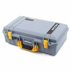 Silver & Yellow Pelican 1525 Air case.  With Foam.