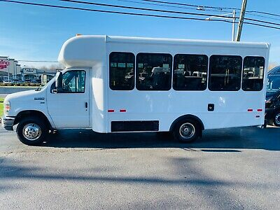2010 E350 12 PASSENGER MINI BUS WITH ONLY 14024 MILES AND A HANDICAP LIFT