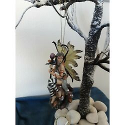 Fairy Wind Chime fairy sitting on a toadstool