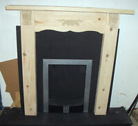 SOLID PINE SMALL  FIRE SURROUND FANCY CORBELS AND CENTRE CARVING