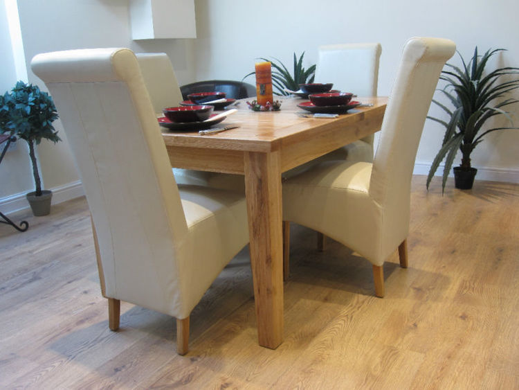 extending solid oak dining table and four ivory bonded