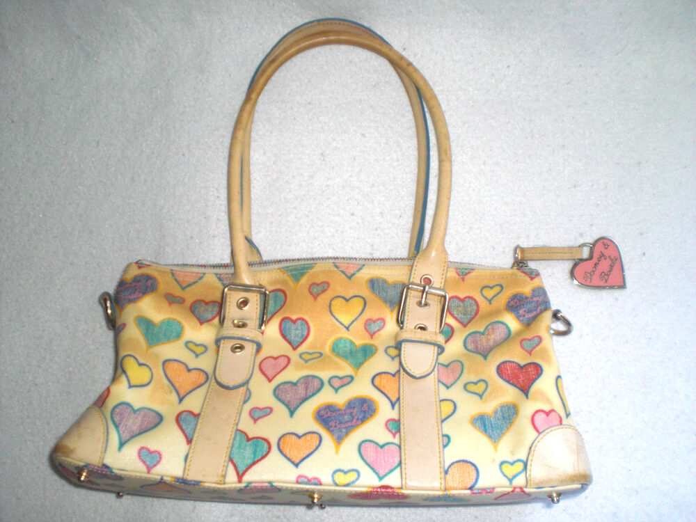 The purses are exclusive to Disney Parks and not available where regular Dooney & Bourke bags are sold. Pictures of the Disney Dooney & Bourke designs, courtesy of the DIS Boards and my own collection: (as always, click for full-size picture) Medium Cindy .