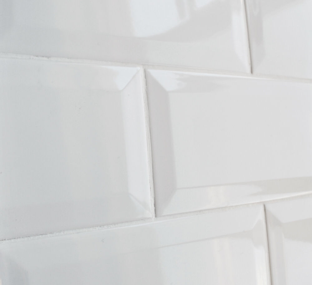 soft white 4x8 subway beveled ceramic tile wall and