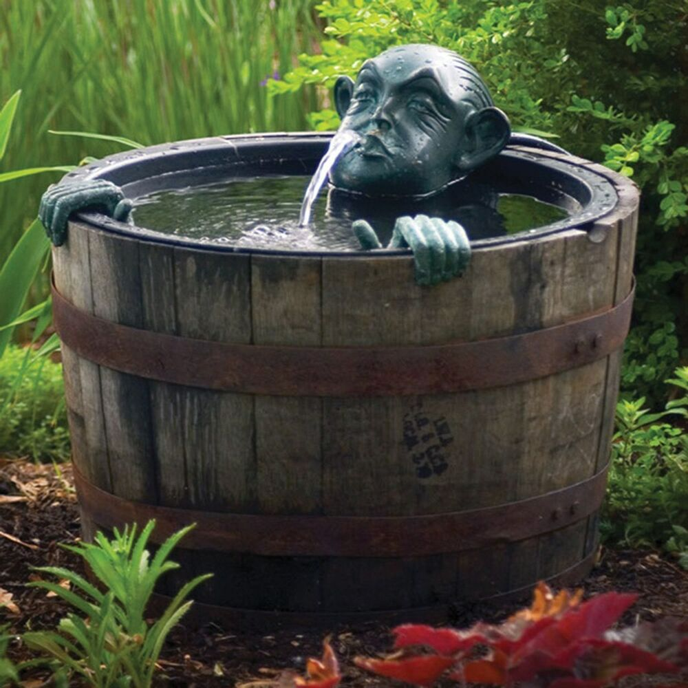 Pond fountain decorative man in barrel pump water feature for Garden pool fountains