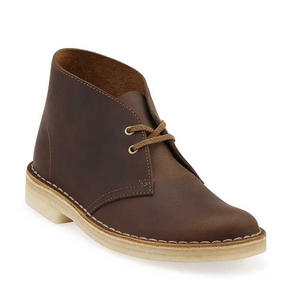 Defining a desert boot is easy: it's an ankle-height lace-up boot, most commonly with a beige or khaki-colored suede upper and a crepe sole. In other words, it's a two-eyelet chukka boot .