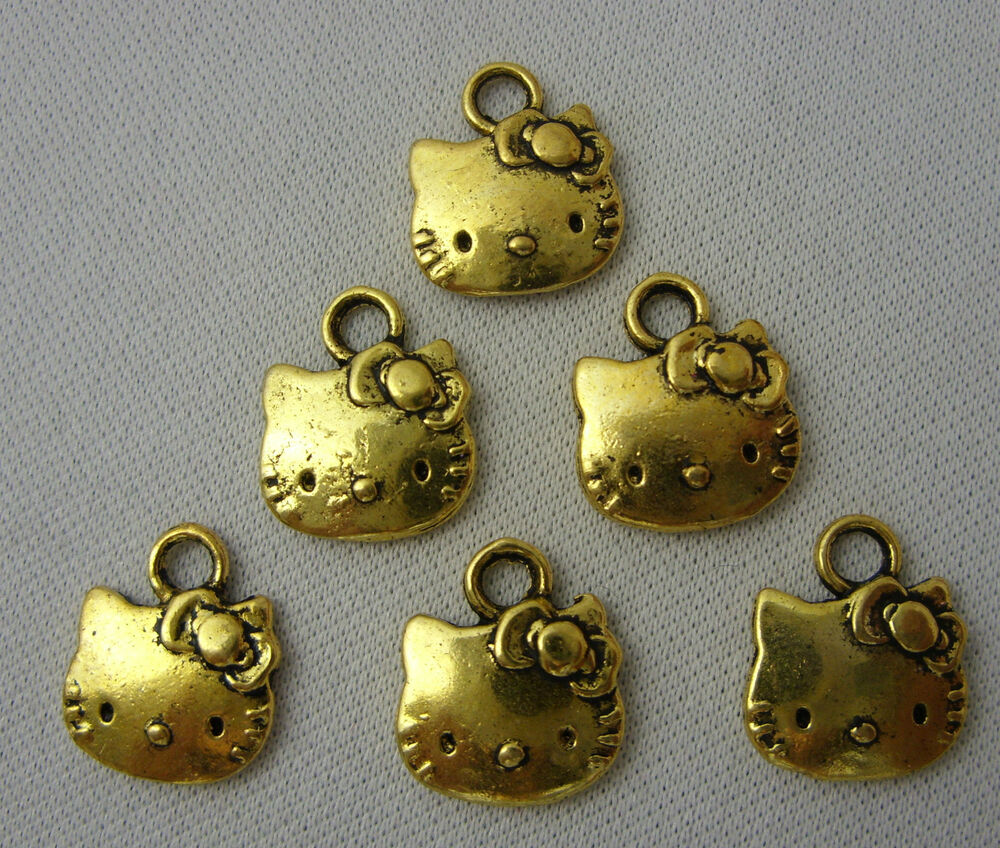 6 x gold golden hello kitty gesicht charms f r. Black Bedroom Furniture Sets. Home Design Ideas