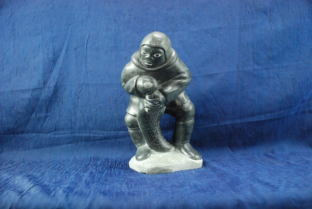 Large inuit eskimo soapstone sculpture of hunter with seal