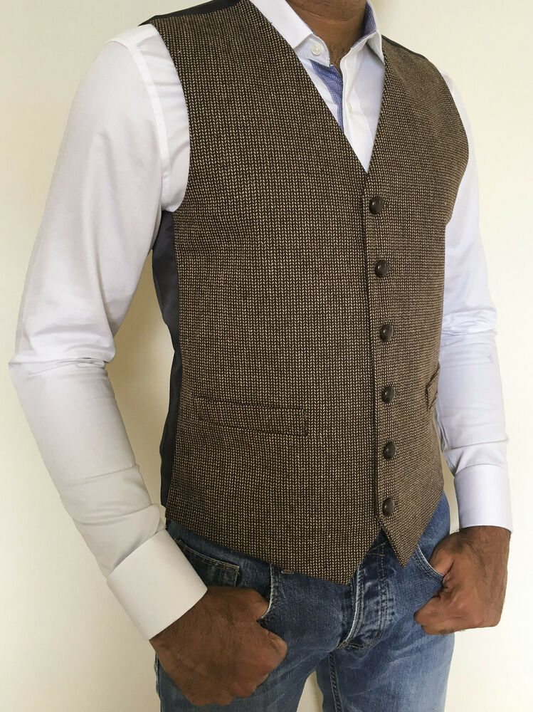 Mens Light Brown Tweed Wool Waistcoat with Tree of Life Embroidery. This Celtic Tree of life Waistcoat in wool is accented with heavy brass buttons, front pockets and Celtic tree of life embroidery in the upper back. This waistcoat is inspired by folk, and cottage chic style.
