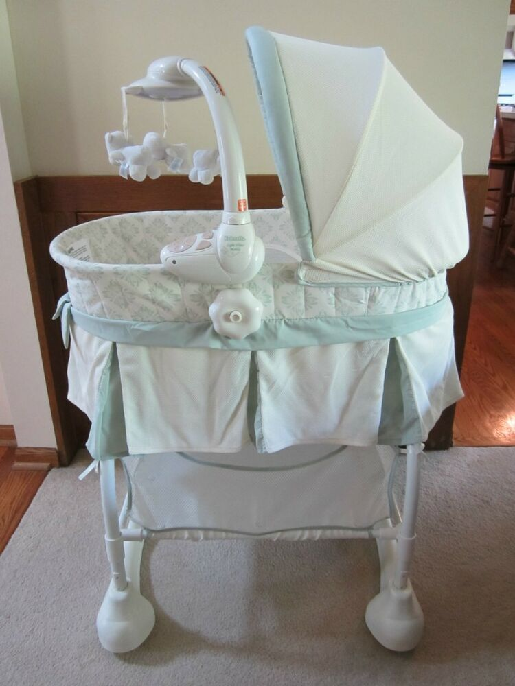 Kolcraft Cuddle N Care Rocking Bassinet With Light Vibes