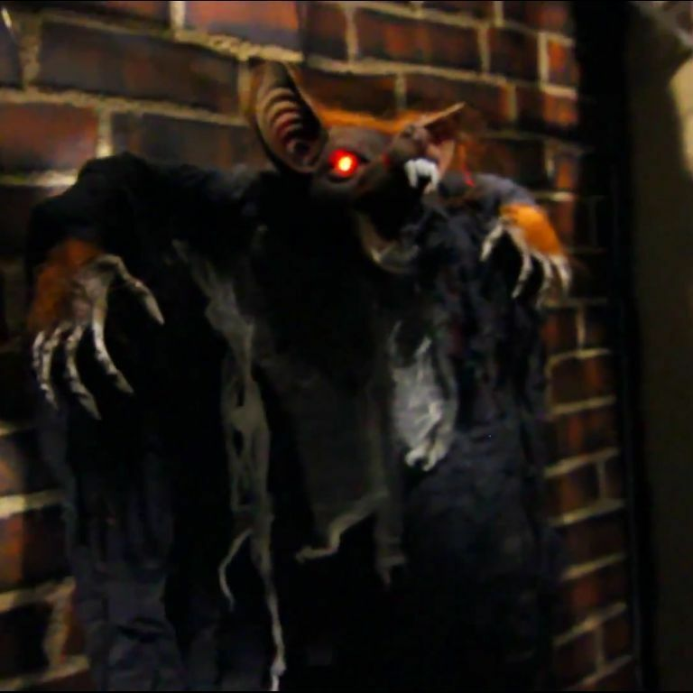Animated hanging bat light up halloween haunted house for Animated halloween decoration
