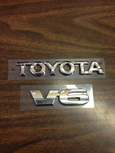 toyota tacoma tailgate emblems set of 2 fits years 2005. Black Bedroom Furniture Sets. Home Design Ideas