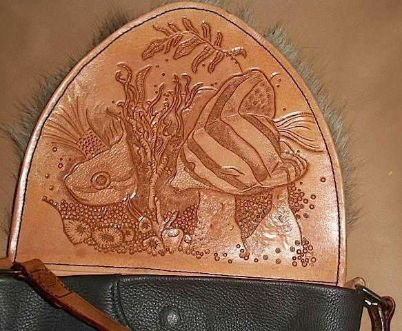 Hand carved leather across body purse with reindeer fur