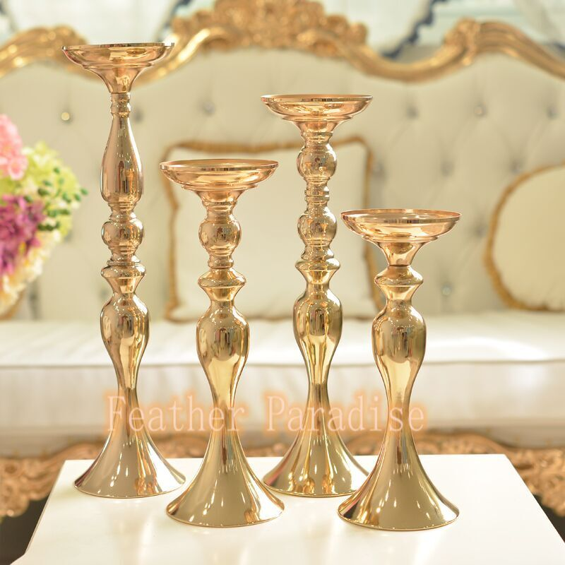Gold wedding floral stand for feather ball candle