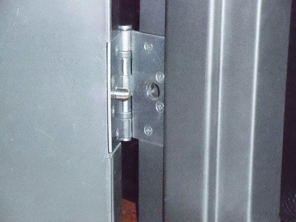 Guard steel out swing doors prevent lift after hinge