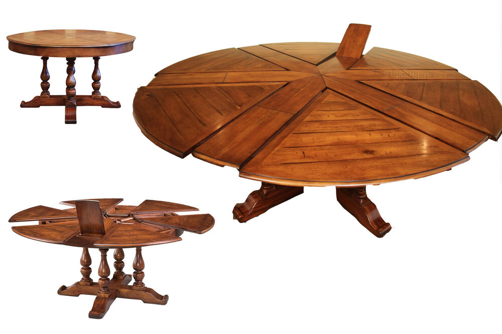 Round dining table with hidden leaves solid walnut for Solid wood round dining table with leaf