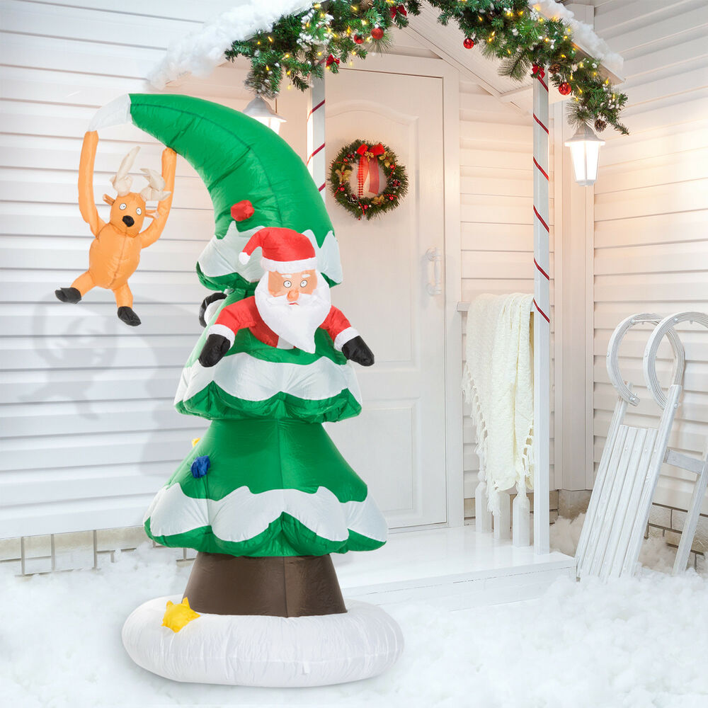 7 39 inflatable led lit santa claus stuck in christmas tree for Holiday lawn decorations