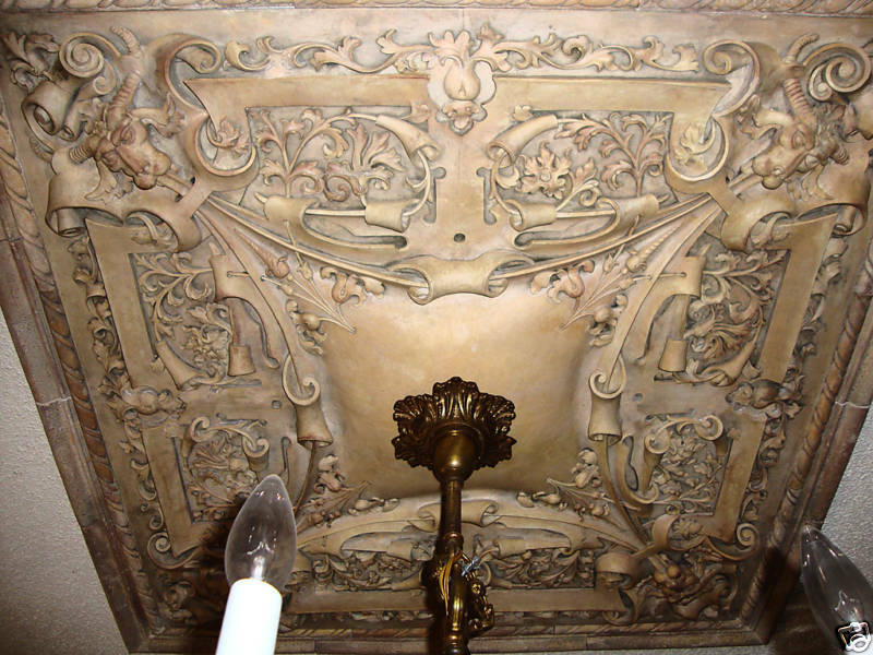 Gothic medallion ceiling chandelier stone wall tile relief