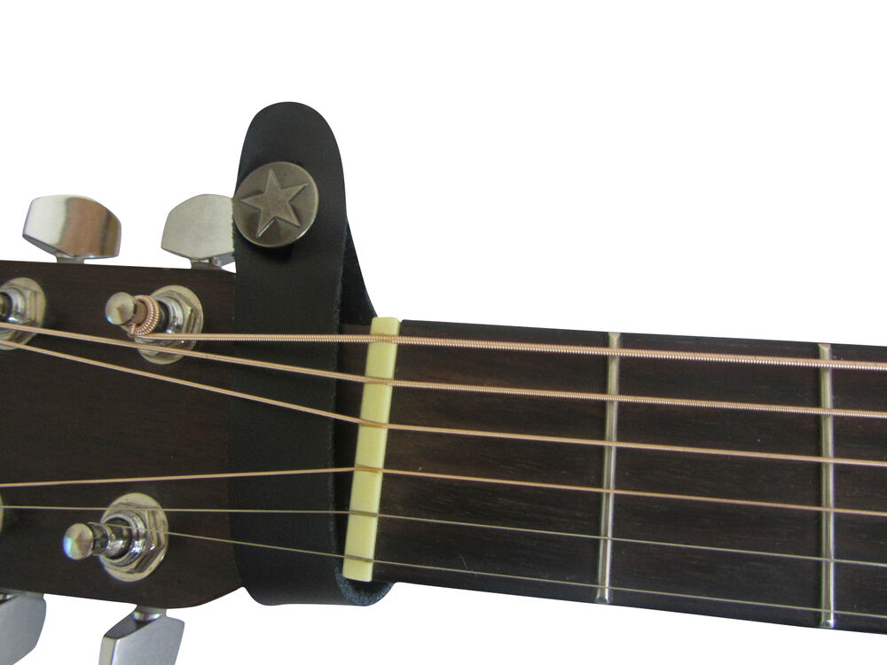 how to hold acoustic guitar with strap