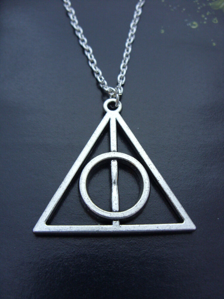 a silver tone harry potter the deathly hallows charm