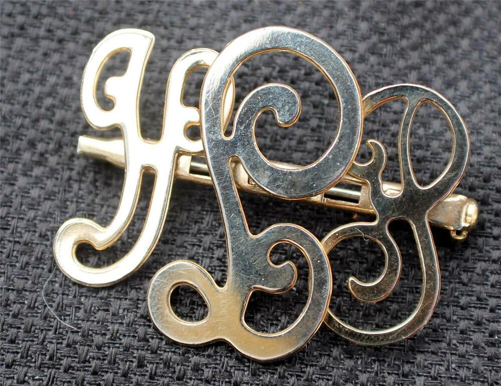 vintage signed pat pend goldtone monogram pin brooch