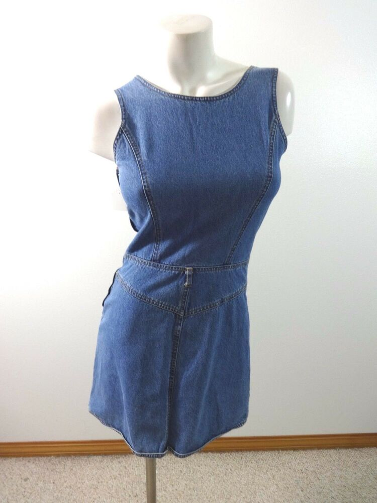 Denim jumper dress by Original Penguin is a must-have addition to your wardrobe Casual dress features button detailing at inset waistline Women's clothing boasts sleeveless styling.