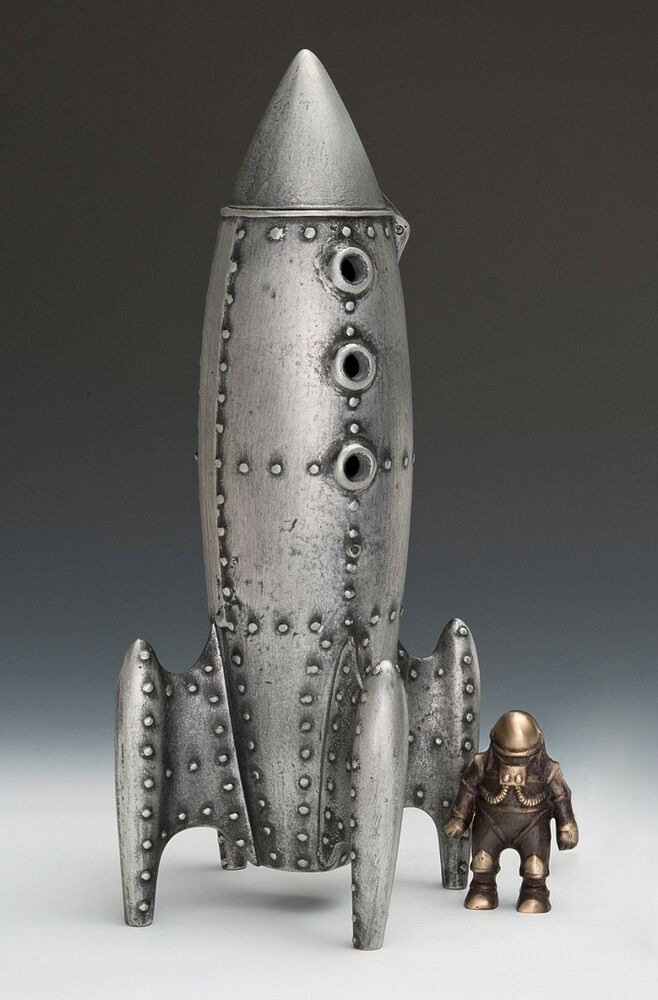 Scott nelles moon rocket coin bank with spaceman ebay - Rocket ship piggy bank ...