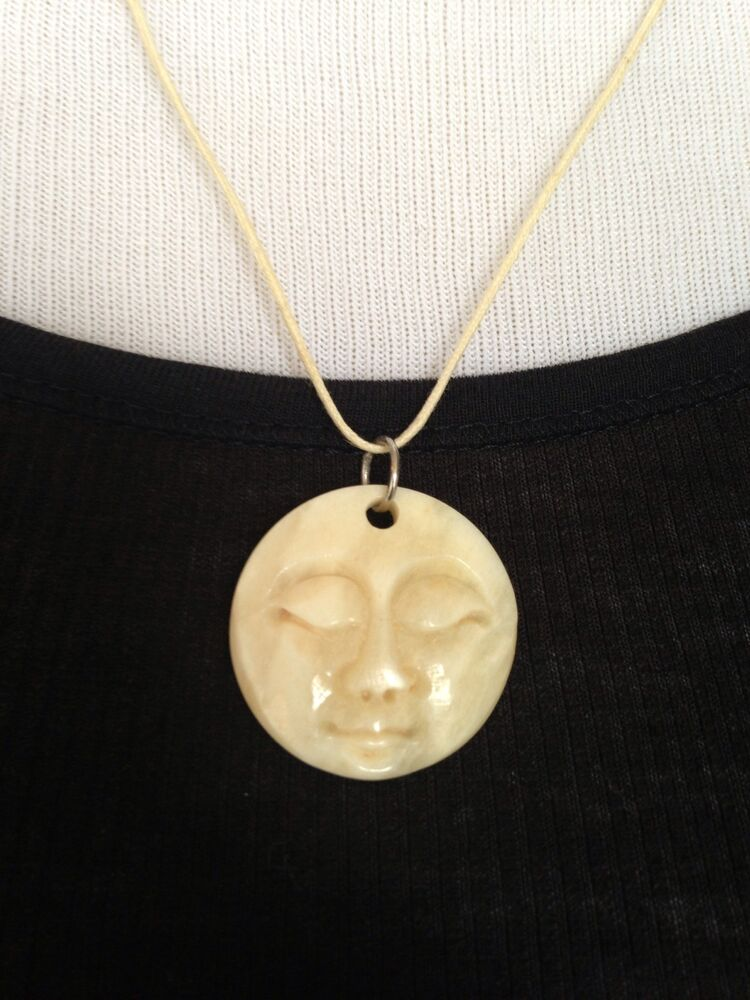 Brand new hand carved bone full moon face necklace ivory