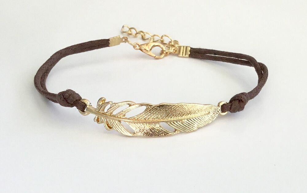 20ffd5ef288a Details about Gold Toned Metallic Feather and Brown Cord Bracelet -  Adjustable 7.5