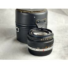 Olympus 24mm f2.8 OM mount lens with case