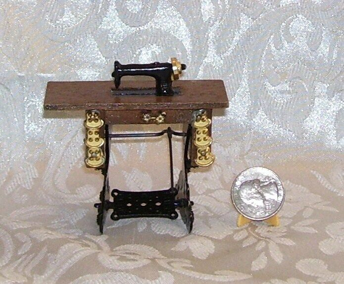 Old Fashion Singer Sewing Machine In A Table