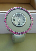 Watch Womans Cuff round white face-pink rhinestone trim,  silver  colored band,