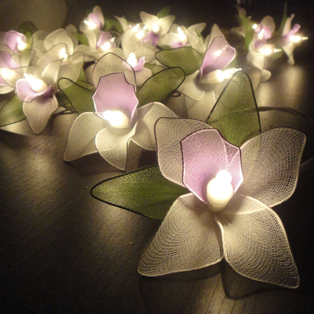 White orchid flower fairy string lights wedding party