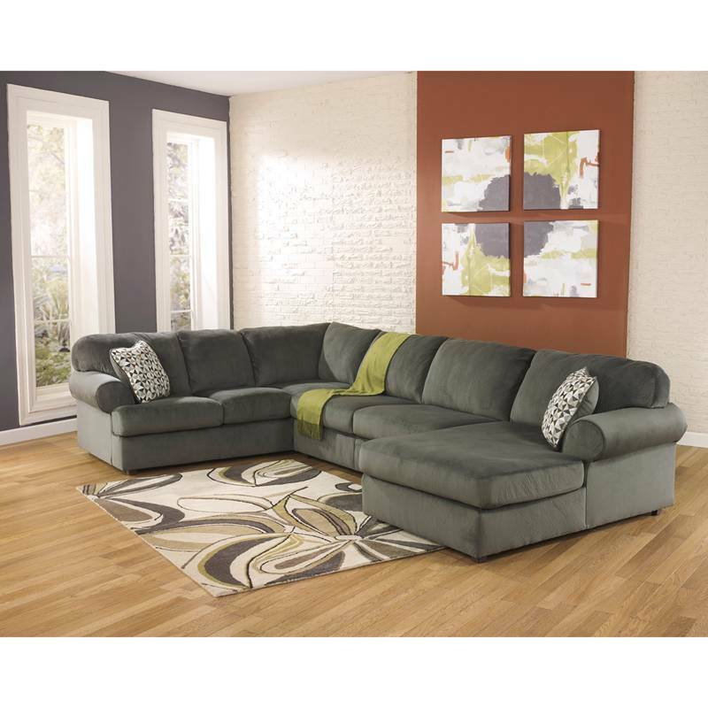 Signature design by ashley jessa place sectional in pewter for Sectional sofas room place