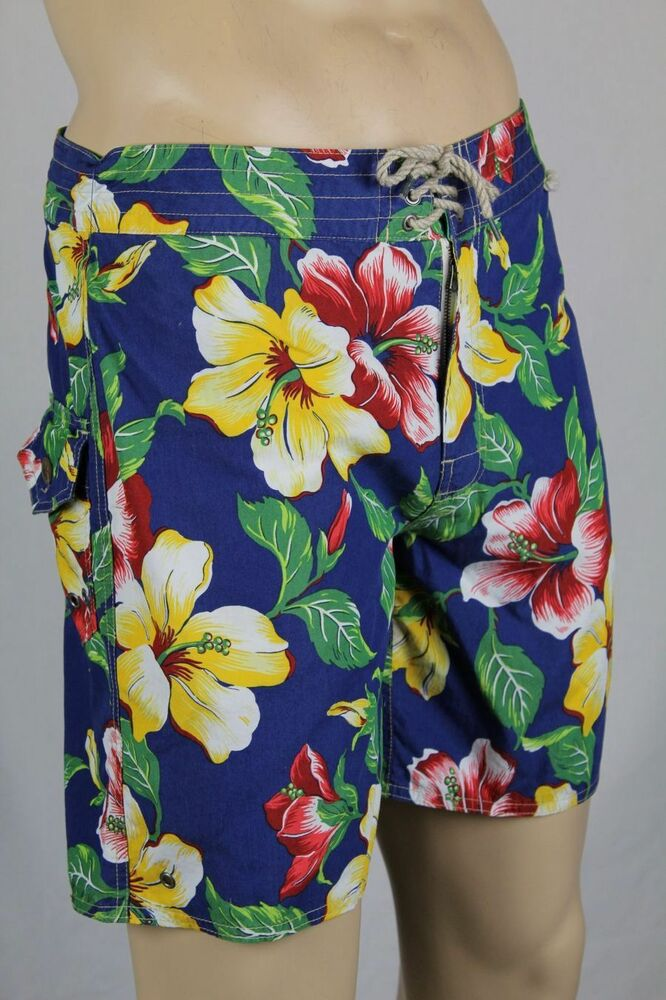 Lounge poolside in these tropical-style swim shorts made with lightweight, quick-drying fabric for an easy transition to out-of-water activities.