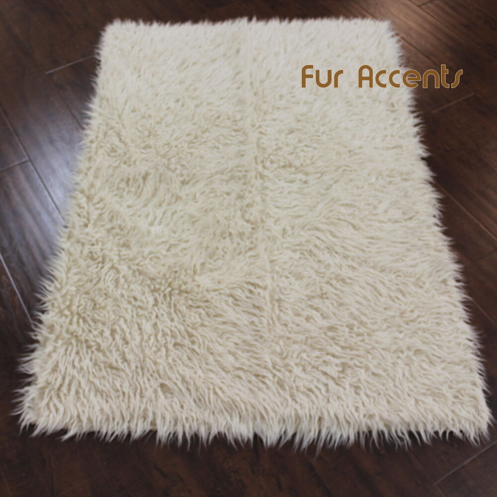 Fur accents shaggy mongolian sheepskin faux fur area rug for Fur rugs