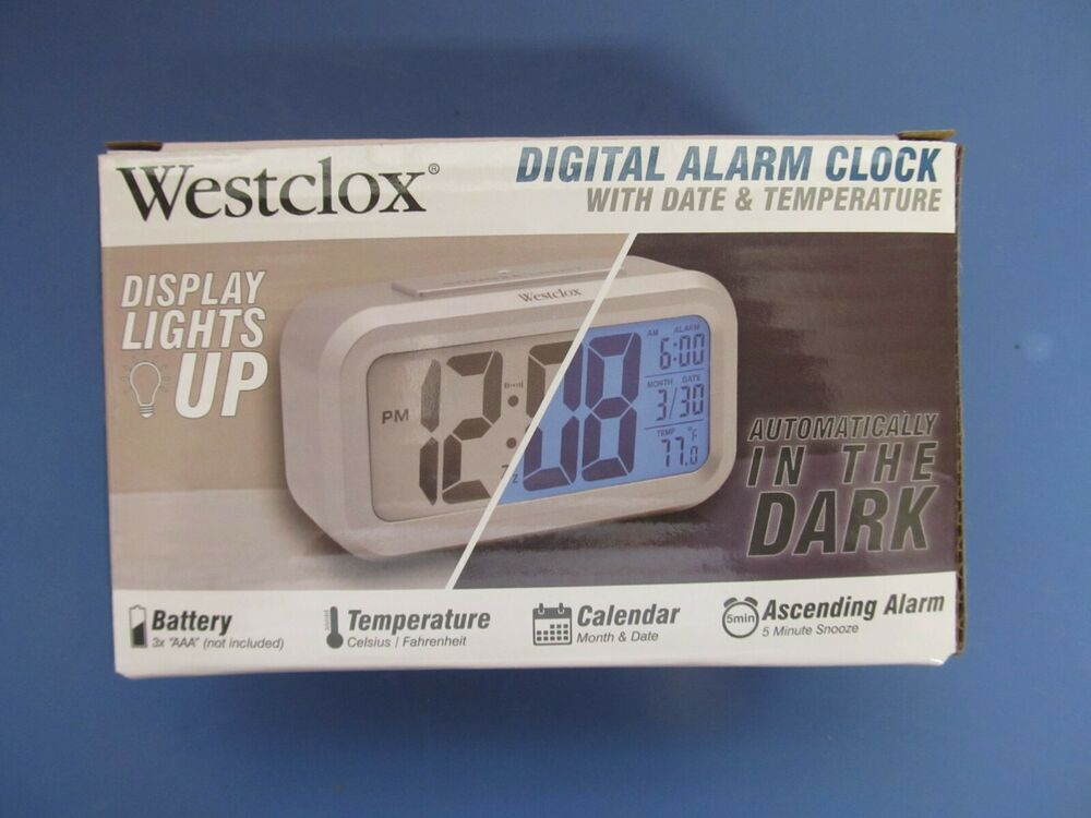 new westclox blue lcd alarm clock 70045a battery powered silver digital ebay. Black Bedroom Furniture Sets. Home Design Ideas