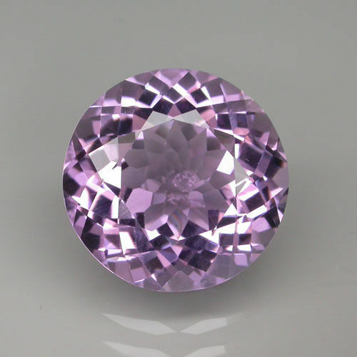 A PAIR OF 5mm ROUND-FACET LIGHT-PURPLE NATURAL BRAZILIAN ...