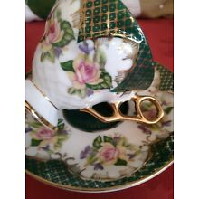 Vintage Teacup and saucer no label Green and gold